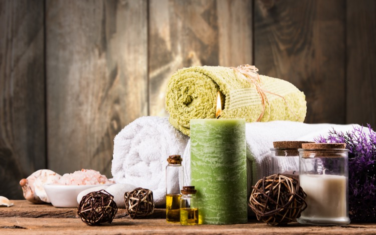 Supplies for a romantic massage like towels and candles