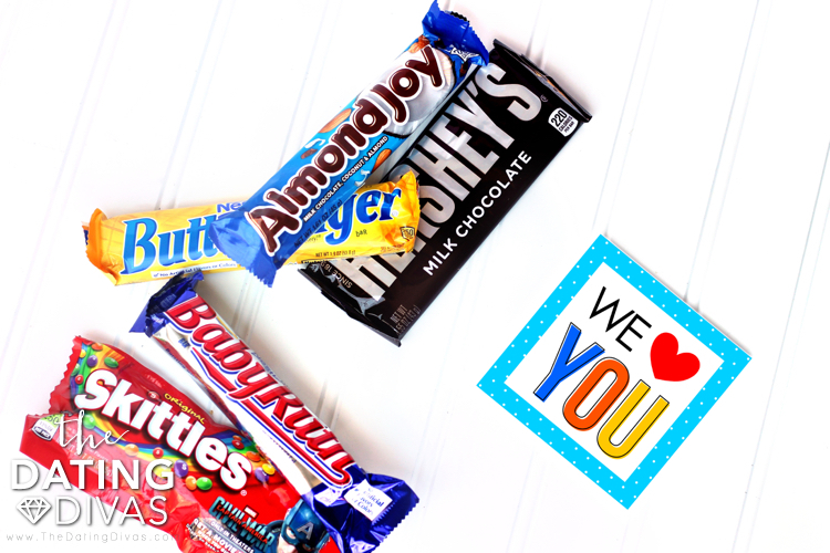 Candy bars on a white surface with a card