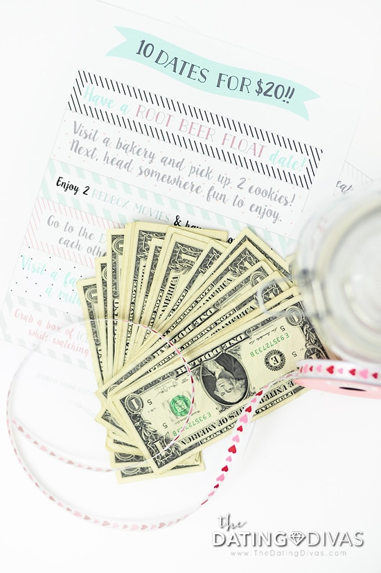 Dollar bills splayed out ready to go into Date Night Jar