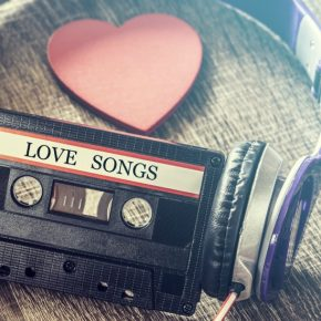 Mix tape with headphones labeled love songs