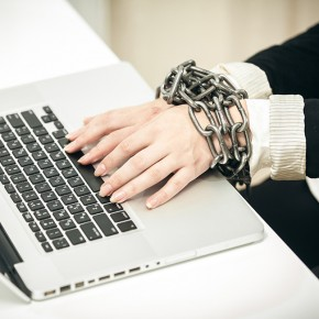 Women chained to desk_square