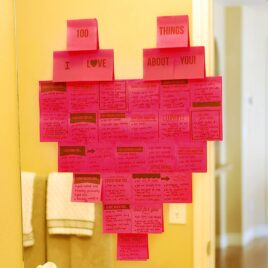 100 Things I Love about You Sticky Notes in the shape of a heart on a mirror