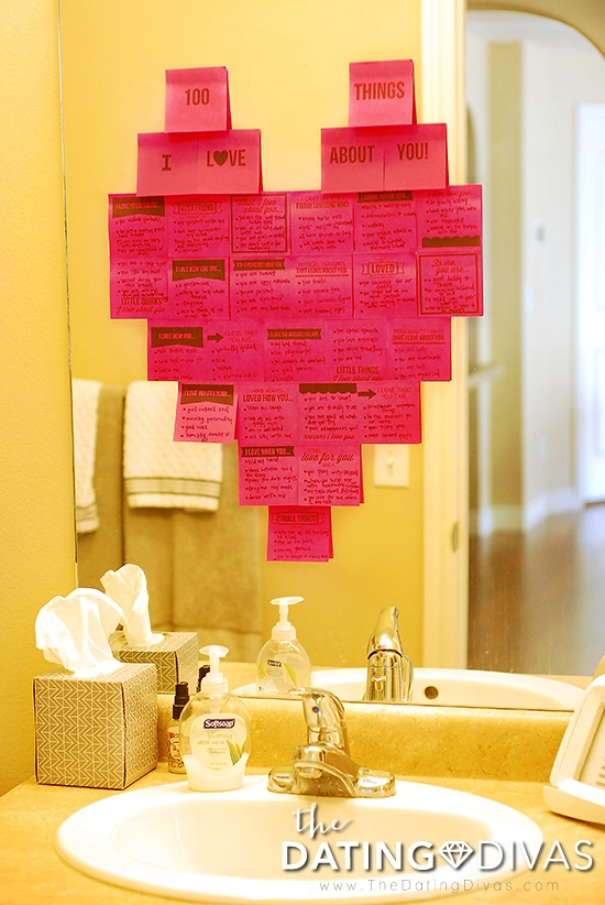 100 things I love about you written on pink sticky notes in the shape of a heart on bathroom mirror