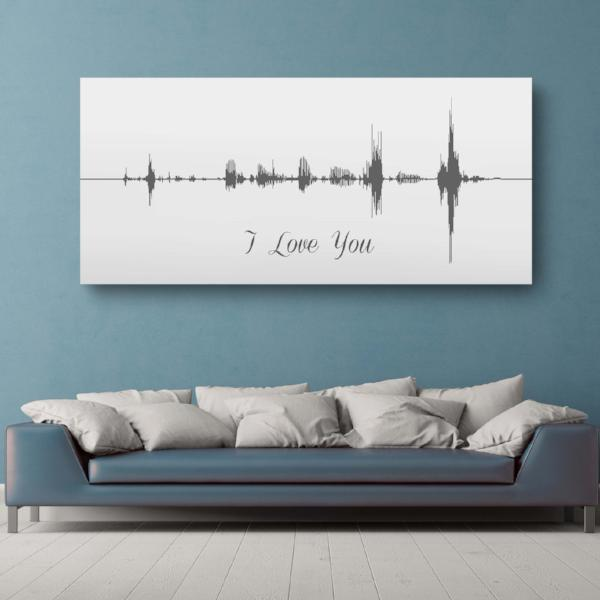 sound wave art on blue wall above couch