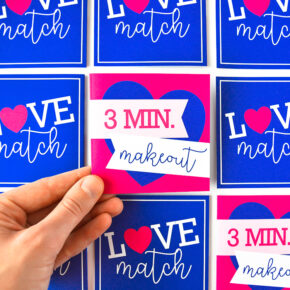 Close up of a love match game with 3 min makeout card over turned