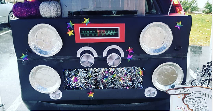 A trunk decorated as a large music player for a trunk or treat Halloween event. A unique trunk or treat decorating idea. | The Dating Divas