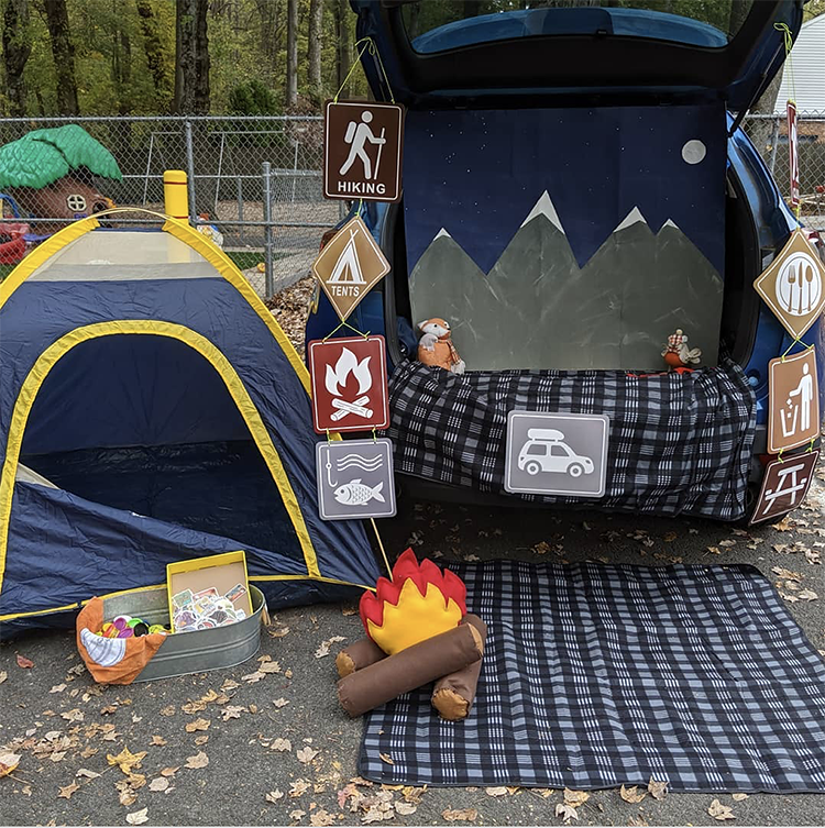 Trunk or Treat decorating with a camping theme - including a camping tent, campfire and mountain range | The Dating Divas