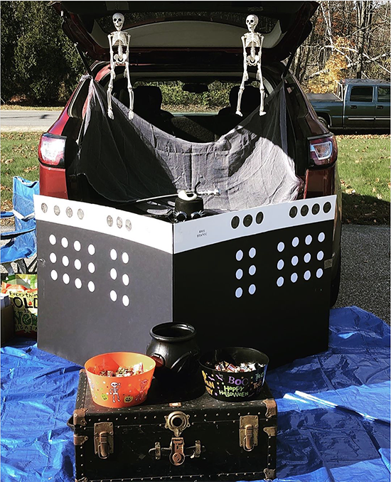 A trunk decorated as a large cruise ship for a trunk or treat Halloween event. A fun trunk or treat decorating idea. | The Dating Divas