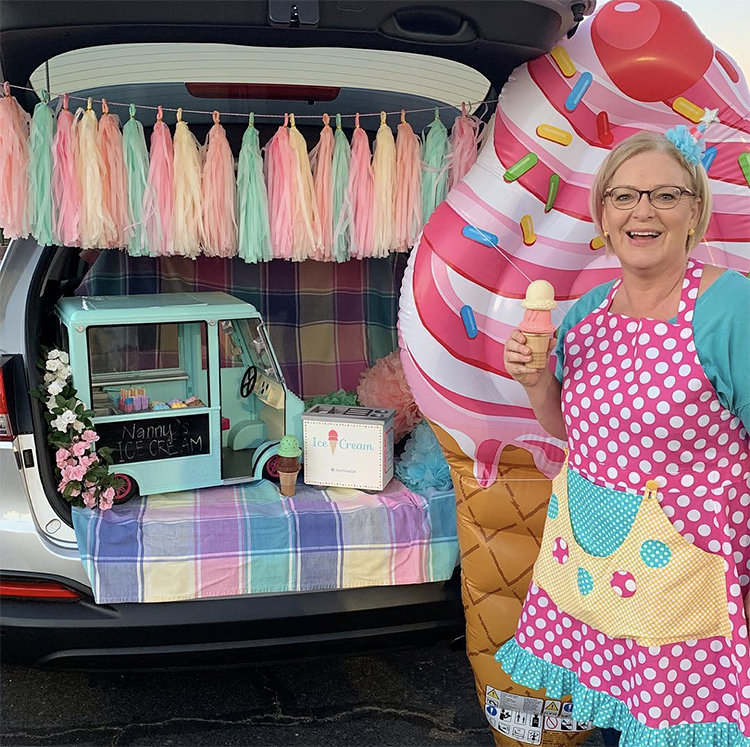 A trunk decorated with a colorful banner and ice cream store decor as part of a trunk or treat Halloween event. A fun Trunk or Treat theme idea. | The Dating Divas