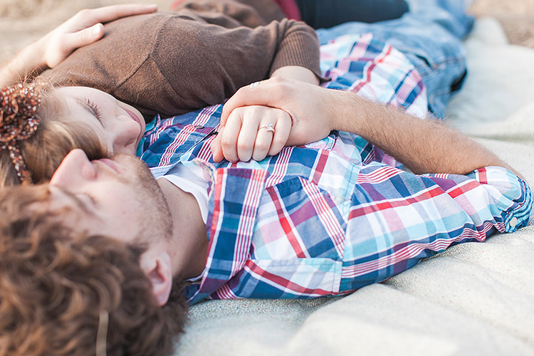 Laying down brings couples together for their photoshoot. | The Dating Divas