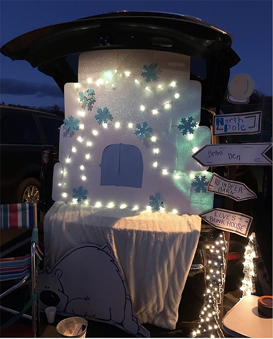 A trunk decorated with snowflakes and Christmas lights as well as signs indicating the directions to the North Pole. A fun trunk or treat theme idea. | The Dating Divas