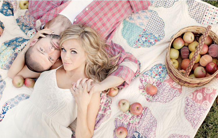 Couple picture laying down on a picnic blanket. | The Dating Divas