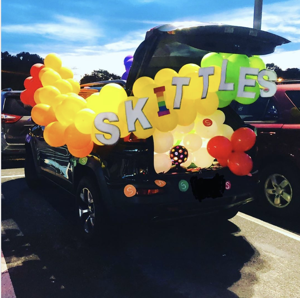 A colorful trunk display using balloons in the colors of skittles candy. Car trunk is decorated for a trunk or treat event |The Dating Divas