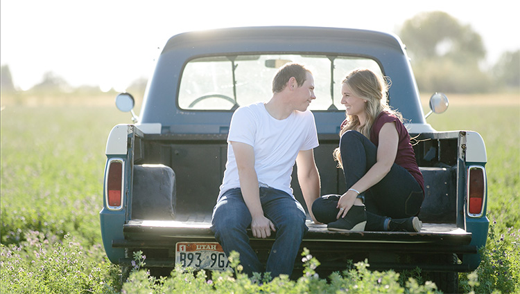 Sitting in a truck bed for a portrait. | The Dating Divas