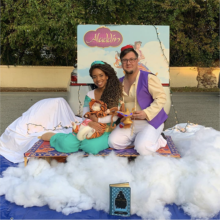 Trunk decorated with fluffy cotton clouds with an Aladdin backdrop and magic carpet - a great trunk or treat idea | The Dating Divas