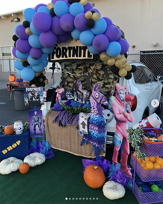 A car trunk decorated for a trunk or treat event using the video game Fortnite. It includes the colors and characters from the video game. | The Dating Divas