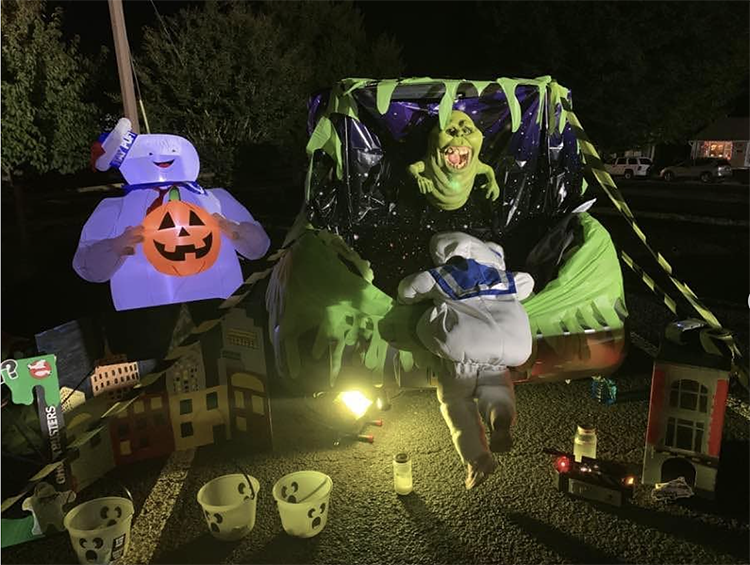 Trunk decorated with a theme for the movie Ghostbusters. It includes characters from the movie. This is a great trunk or treat idea | The Dating Divas