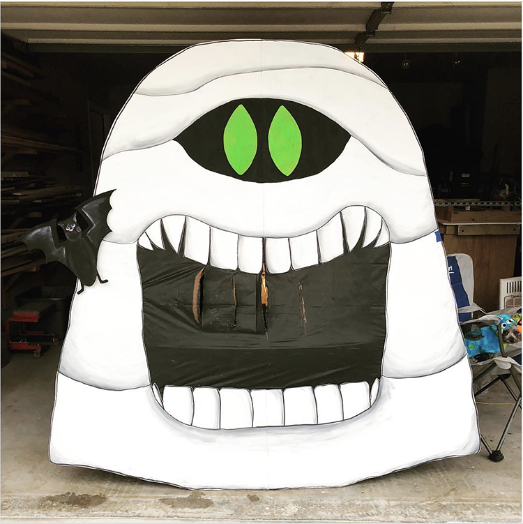 Trunk decorated with a theme for the movie Hotel Transylvania. It includes a large cut out of a mummy character from the show. This is a great trunk or treat idea | The Dating Divas