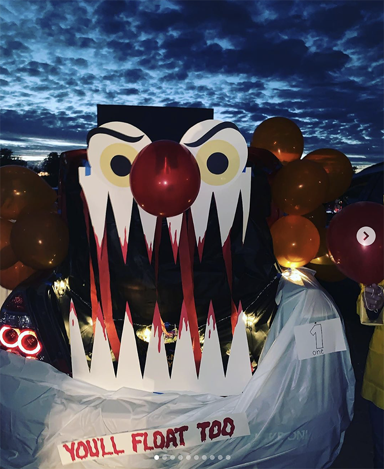 "A trunk decorated as the scary clown from Stephen King's book and movie ""It"". This is a fun idea for a scary trunk or treat theme 