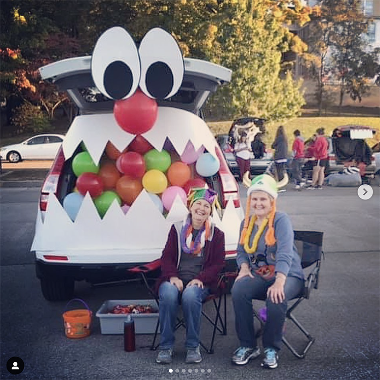 A trunk decorated as a large mouth of a monster. The trunk is filled with balloons giving the look of various colorful candies in the monster's mouth. The trunk is the mouth of the monster. This is a very popular and easy trunk or treat idea. | The Dating Divas