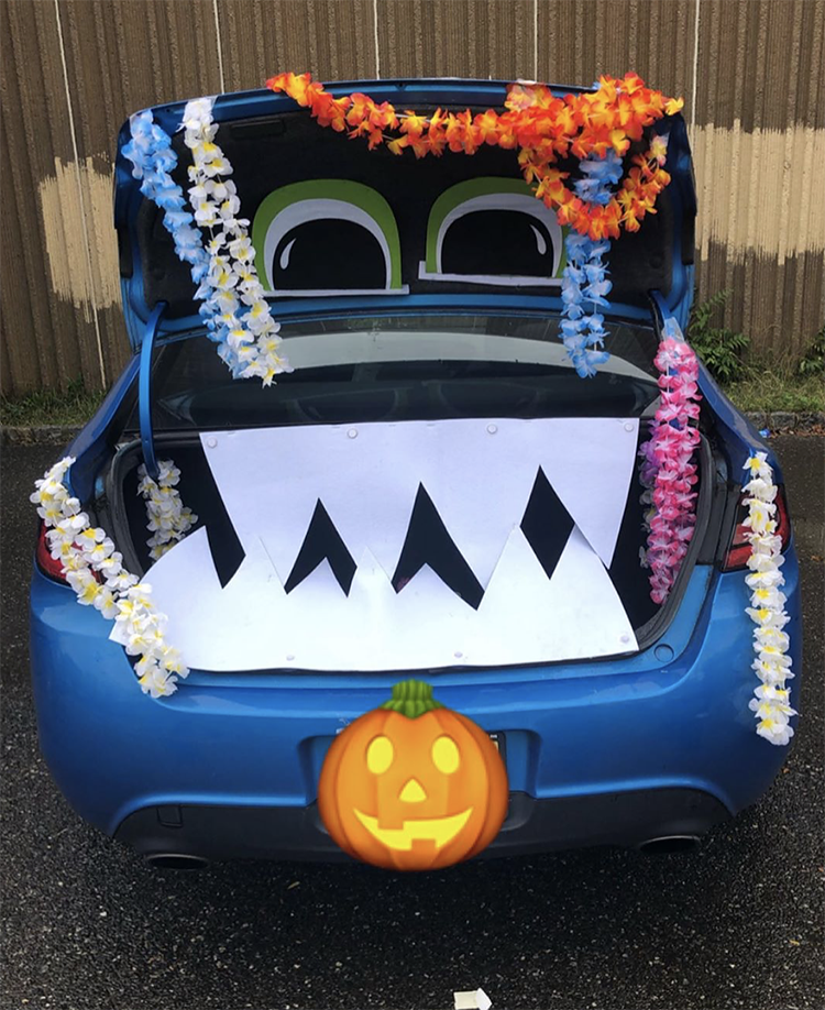 A trunk decorated as a large mouth of a classic Halloween monster. The trunk is the mouth of the monster. This is a very popular and easy trunk or treat idea. | The Dating Divas