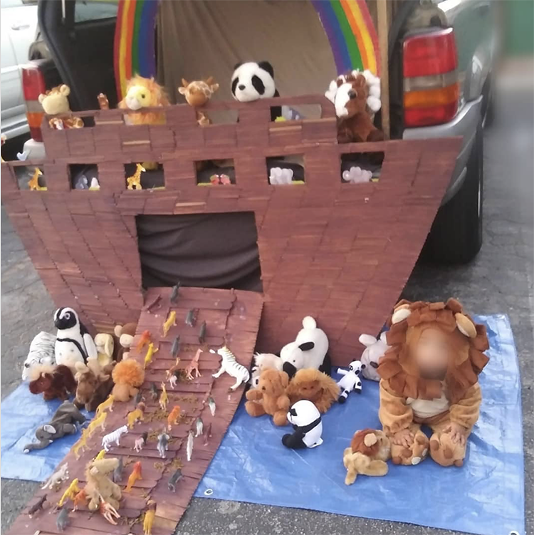 A trunk decorated a the arc of Noah. It has stuffed animals entering boat from the ramp and a large rainbow across the top of the car's trunk. This makes a perfect trunk or treat theme for a church Halloween activity. | The Dating Divas