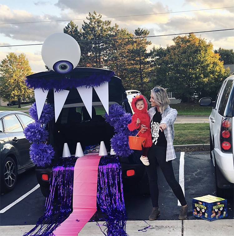 A trunk decorated as a large mouth of a one-eyed monster. The trunk is the mouth of the monster. This is a very popular and easy trunk or treat idea. | The Dating Divas
