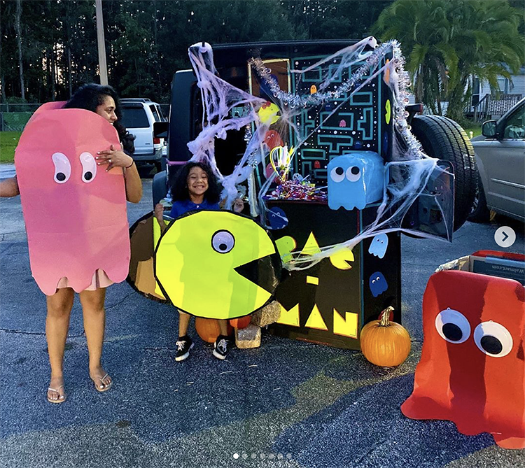 A trunk decorated with a theme from the arcade game Pacman. The trunk decoration include a scene from the classic game and the family has Pacman character costumes to match the theme. This is a super fun theme for Trunk or Treat. | The Dating Divas