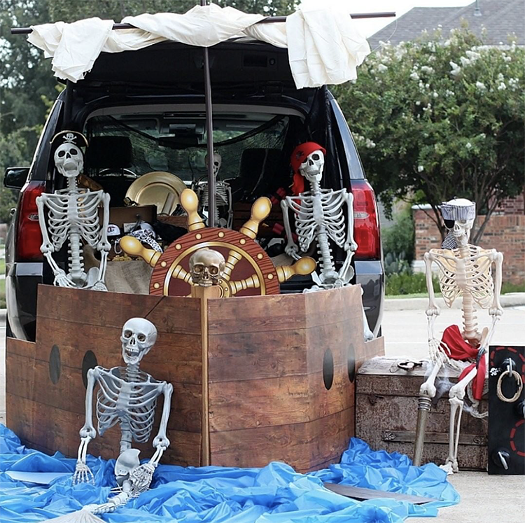 A trunk decorated as a large pirate ship manned by skeletons. A fun trunk or treat theme idea. |The Dating Divas