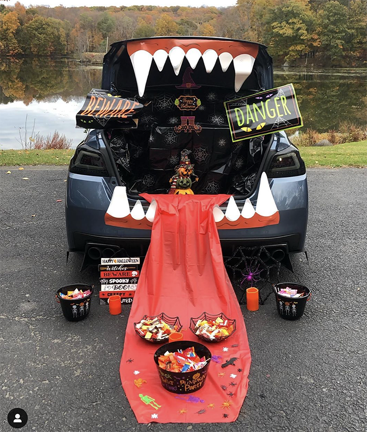 A trunk decorated as a large mouth of a scary monster. The trunk is the mouth of the monster. This is a very popular and easy trunk or treat idea. | The Dating Divas