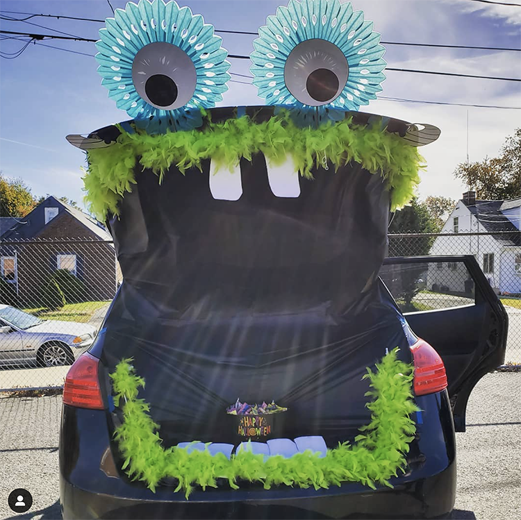 A trunk decorated as a large mouth of a surprised monster. The trunk is the mouth of the monster. This is a very popular and easy trunk or treat idea. | The Dating Divas