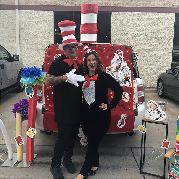 Trunk decorated with a theme for the book, movie and tv show The Cat in the Hat by Dr. Seuss. It includes a couple in Cat in the Hat costumes to coordinate with the theme. This is a great trunk or treat idea | The Dating Divas