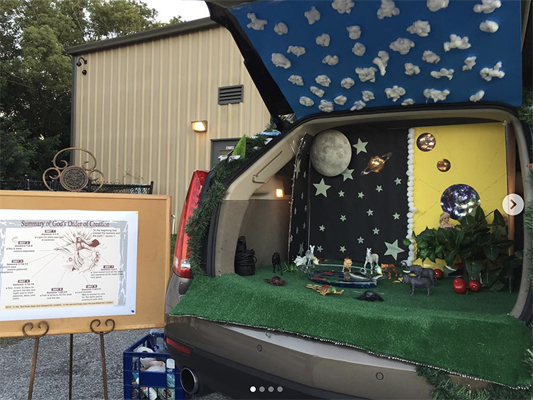 A trunk decorated with representations of the creation as recorded in Genesis in the Bible. This is a unique trunk or treat idea for a church activity. | The Dating Divas