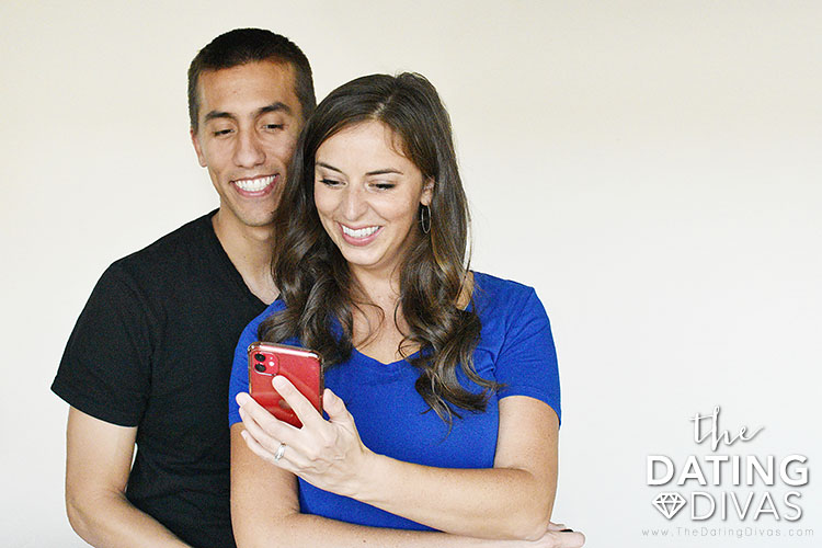 "Couple looking at the app ""Intimately Us""  - a fun and sexy app for couples.  . 