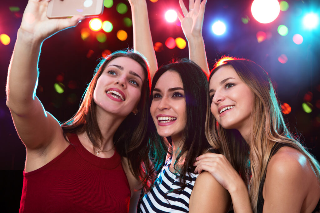 Friends having a girls night out and taking selfies. | The Dating Divas