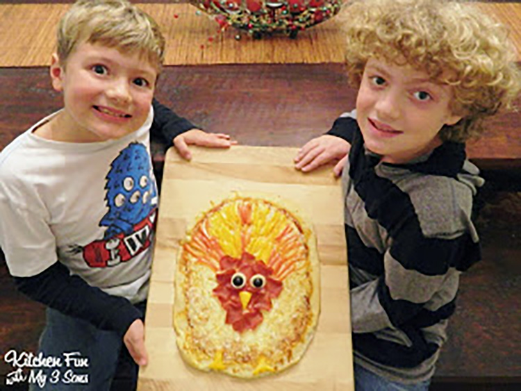 Let the kids make one of these Thanksgiving food ideas - a turkey pizza! | The Dating Divas