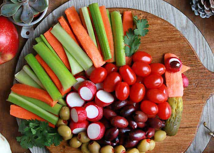 Thanksgiving snacks are best when they are finger foods. This turkey veggie tray fits the bill. | The Dating Divas