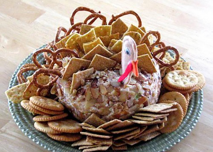 Jazz up your cheeseball with these Thanksgiving food ideas in a turkey shape. | The Dating Divas