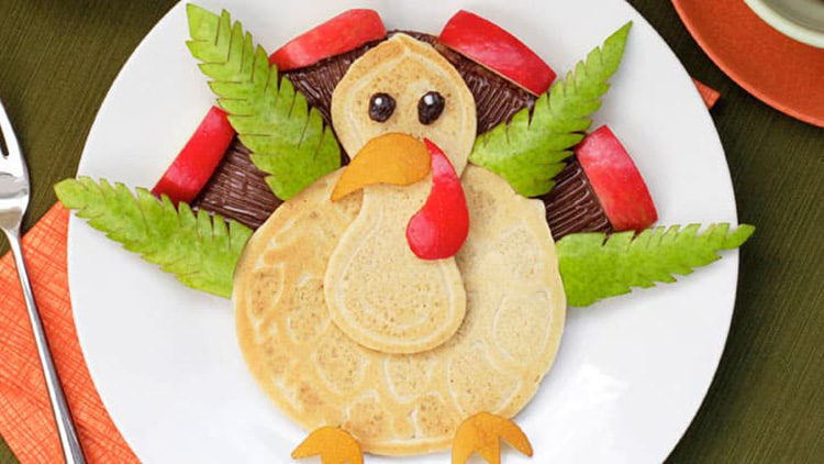 Fruit and pancakes can make an adorable turkey for your Thanksgiving breakfast. | The Dating Divas