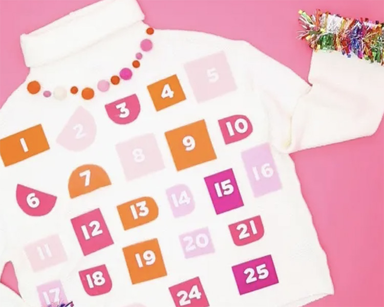 White Sweater Wtih Colorful Pockets for Ugly Christmas Sweater Ideas | The Dating Divas