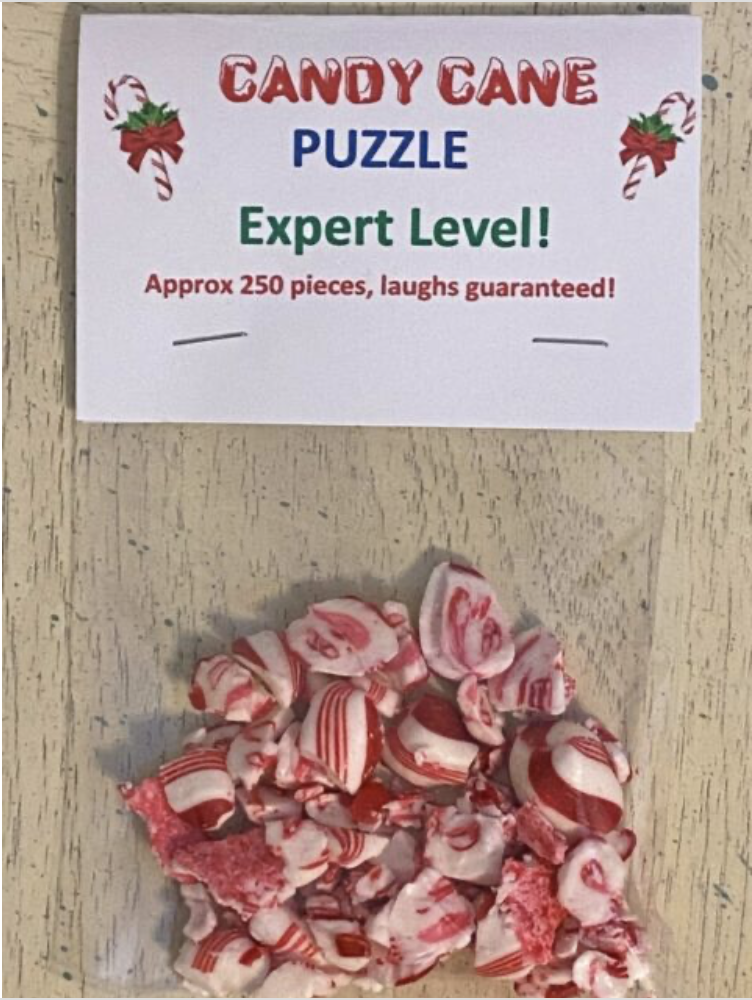 """Candy cane broken into tiny pieces with the bag labeled """"candy cane puzzle"""" used for a white elephant gift exchange 