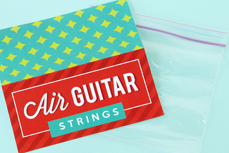 """An empty ziplock bag with a printable label """"Air Guitar Strings"""" - an example of a white elephant gift that is inexpensive and funny 