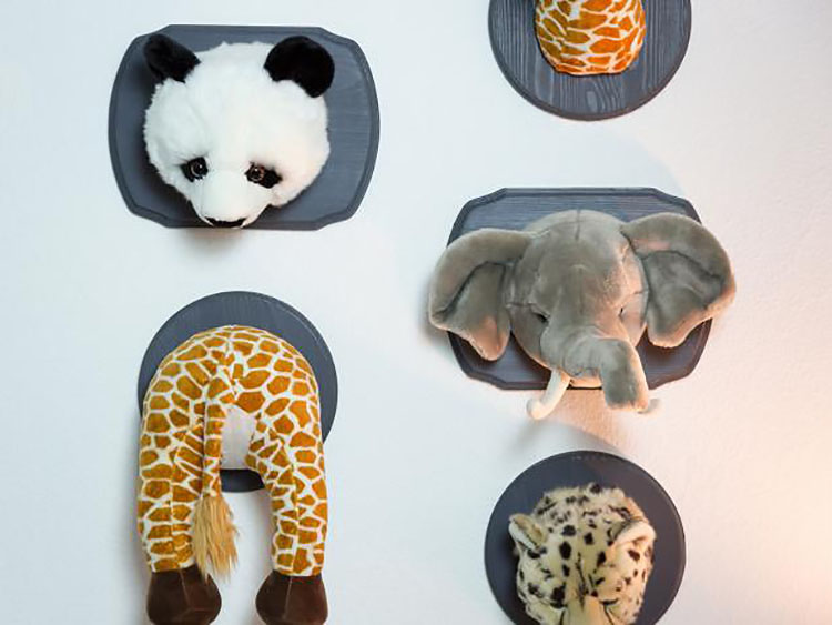 Stuffed animal heads mounted to a plaque for a white elephant gag gift | The Dating Divas