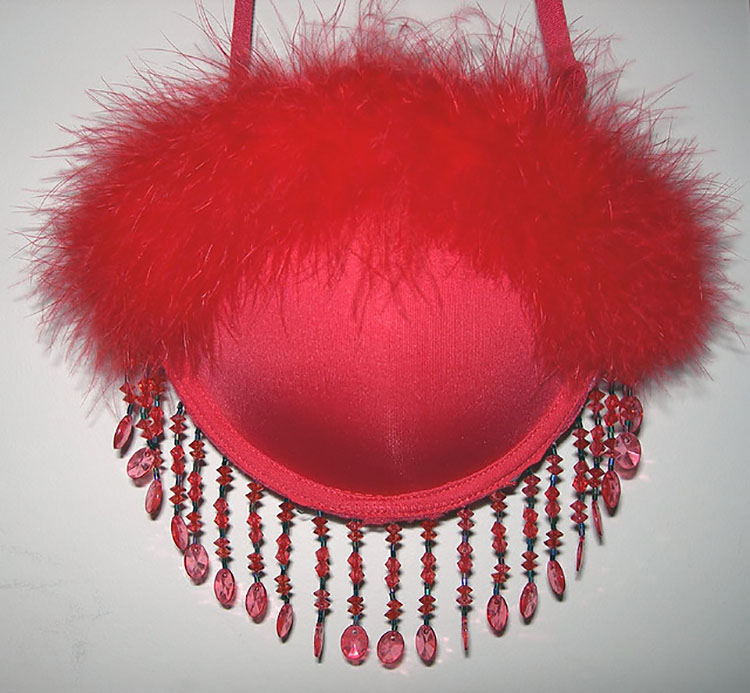 A red bra turned into a purse using feathers and beads - a funny DIY white elephant gift | The Dating Divas