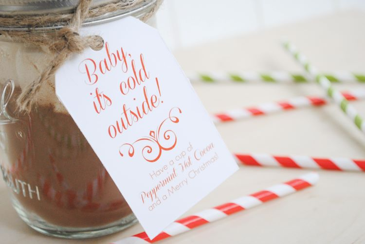 A glass jar filled with homemade peppermint hot cocoa | The Dating Divas