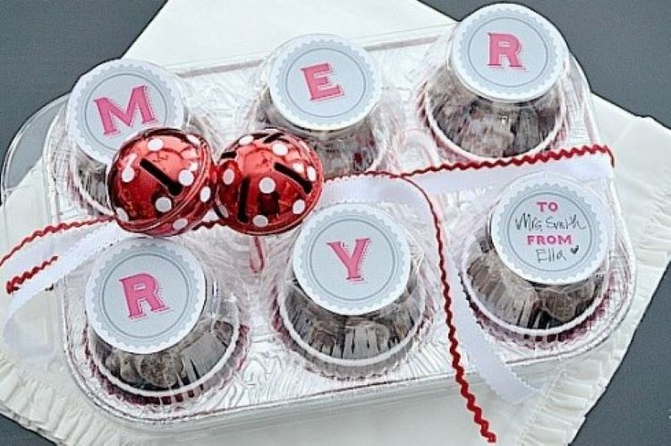 Muffin tin shaped Christmas printables decorating a tray of goodies | The Dating Divas