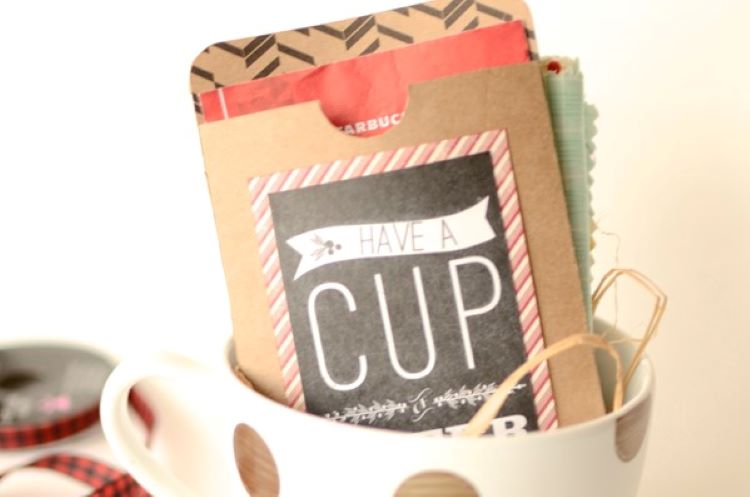 Hot cocoa packets and a gift card inside of a mug | The Dating Divas