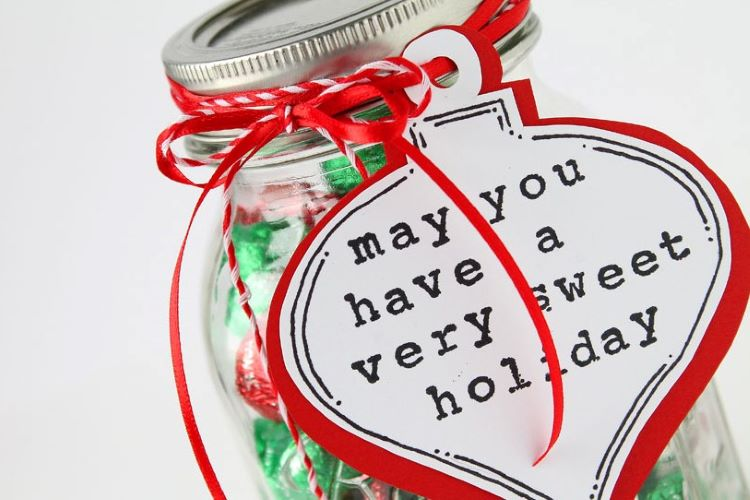A mason jar that's filled with candy and other sweet Christmas treats | The Dating Divas