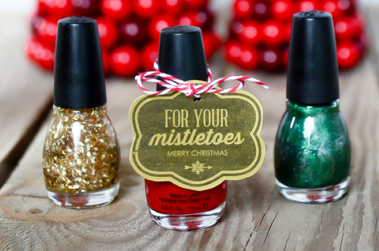 Nail polish bottles tied with a Christmas gift tag | The Dating Divas