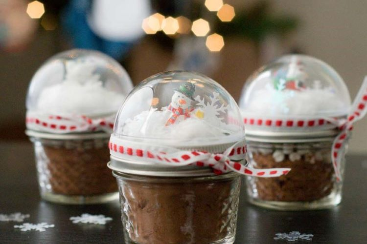 Small jars filled with homemade hot cocoa mix and decorated with a snowman | The Dating Divas